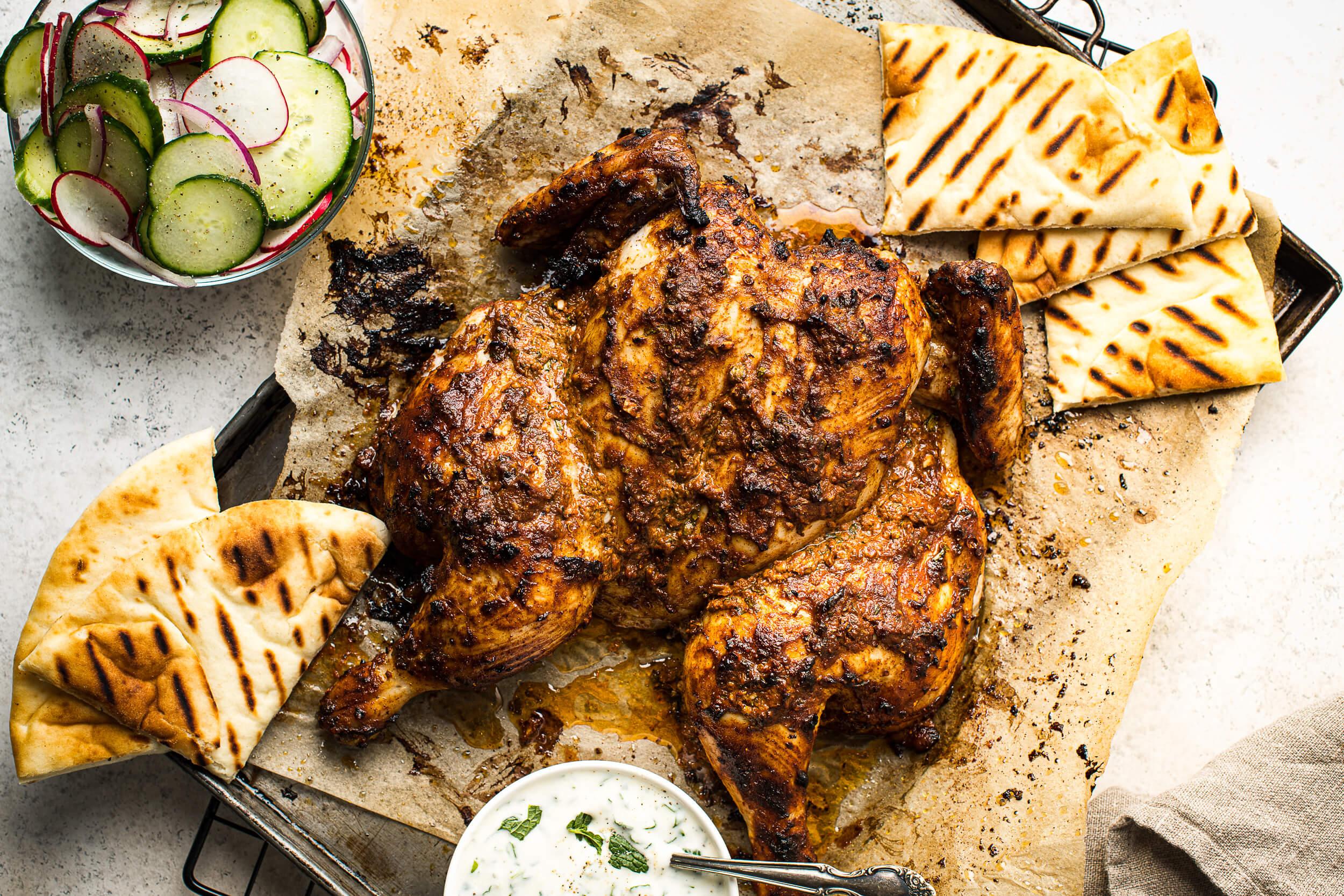 Spatchcocked Tandoori-Style Chicken with Cucumber Salad & Naan